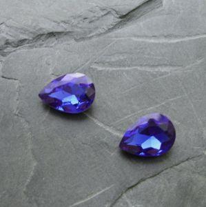 Skleněný broušený kamínek 10x14mm - modrý střední
