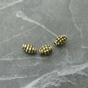 Kovové korálky granáty 7x5mm - starobronzové