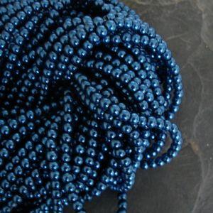 Skleněné voskované kuličky cca 4mm - petrolejové