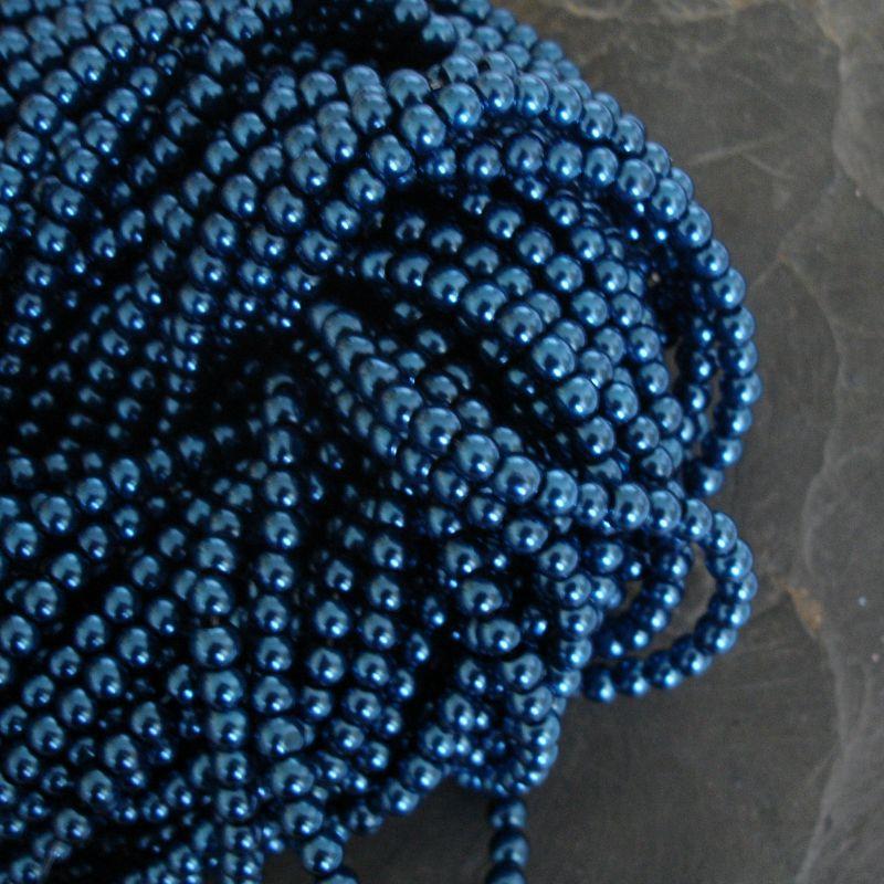 Voskované kuličky cca 4mm - modré perolejové