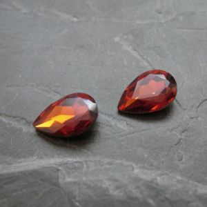 Skleněný broušený kamínek 10x14mm - hnědý