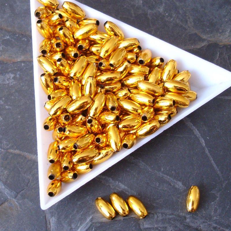 Plastové korálky rýže cca 8x4mm zlaté, mosazné - 50 ks