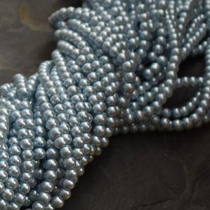 Skleněné voskované kuličky cca 4mm - modré sv.